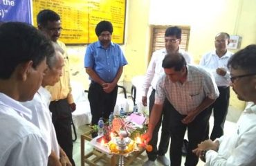 Lig hting candle at the launching of the system by Shri C.K. Dhar Senior Technical Director & SIO