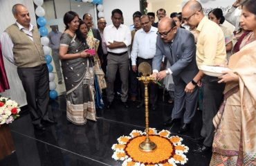 Chief Secretary lighting the ceremonial lamp