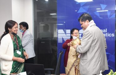 Chief Secretary of Assam Shri Jishnu Barua, IAS being welcomed with Gamusha and Xarai