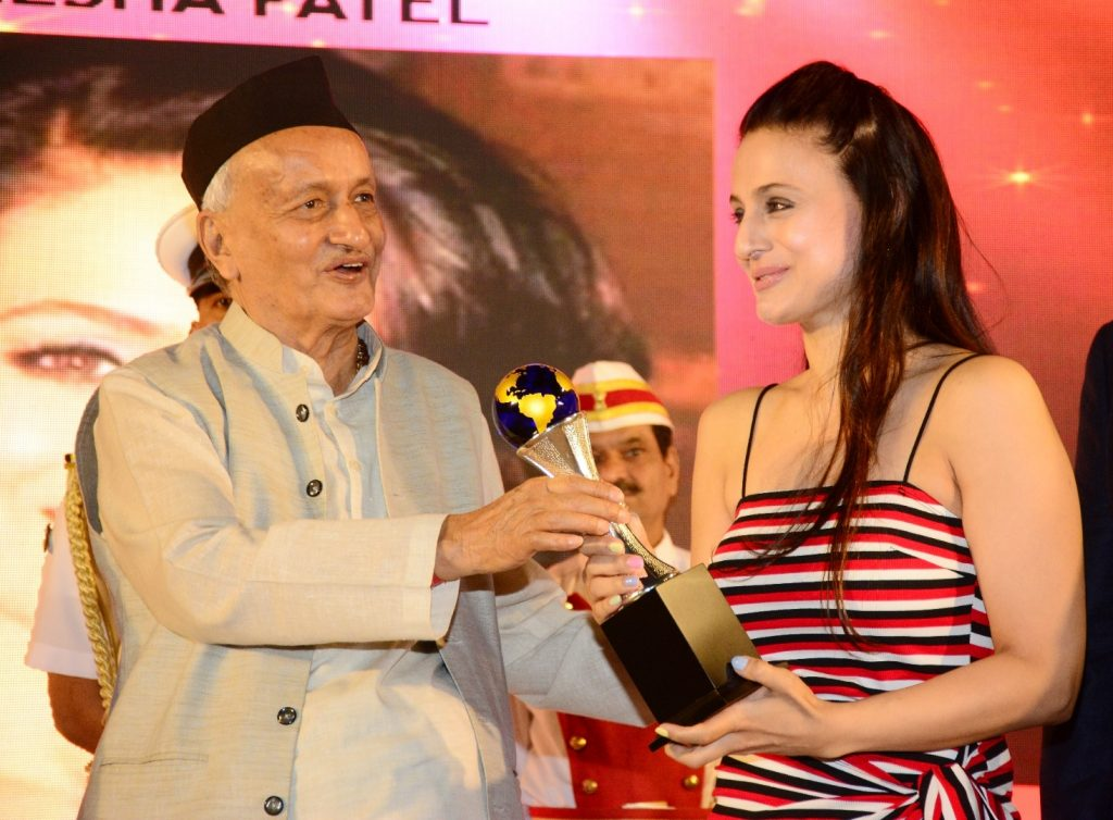 Governor Bhagat Singh Koshyari presented the Lifetime Achievement Award to well known film star Prem Chopra in Mumbai. Playback singer Udit Narayan, actress Ameesha Patel, Dheeraj Kumar, former Mumbai Sheriff Dr Indu Shahani, Maj Gen G D Bakshi, IPS officer Shahida Ganguly were among those who were presented the Dream Achievers' Award instituted by Nana Nani Foundation and Film